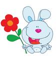 Blue bunny holding a flower vector