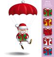 Happy santa parachute holding a gifts vector