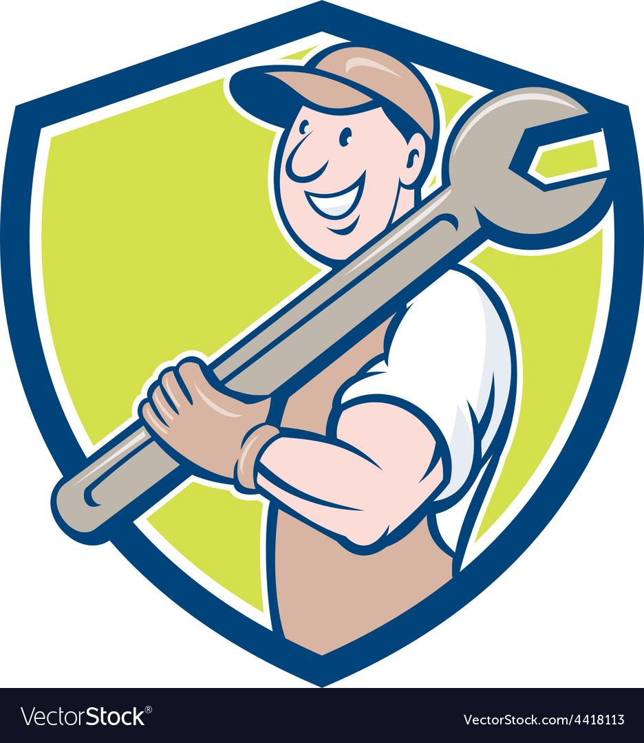 Mechanic smiling spanner standing crest cartoon vector | Price: 1 Credit (USD $1)