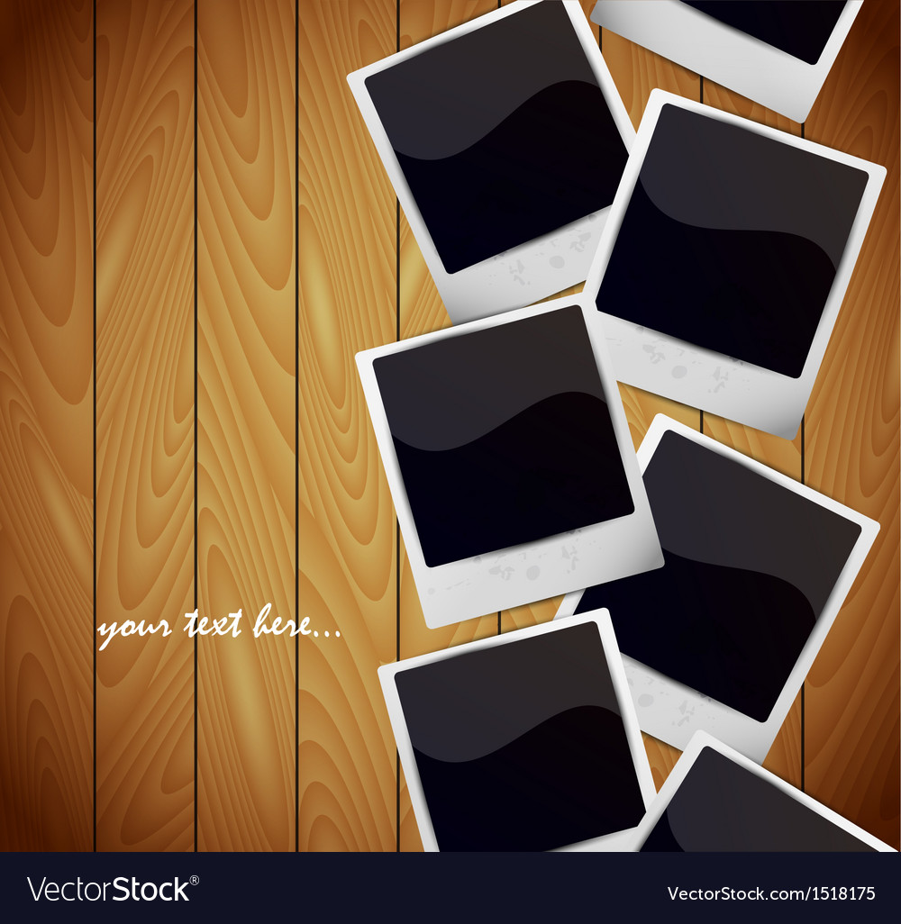 Photo frames on wooden texture vector | Price: 1 Credit (USD $1)