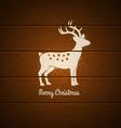 Deer on wooden background vector