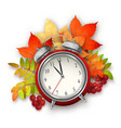 Autumn fall leaves and alarm clock vector