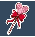 Heart shaped lollypop with bow vector
