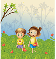 A girl and a boy in the garden vector