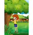 A woman with a cellphone standing under the tree vector