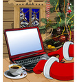 Cartoon santa claus writes a letter on the laptop vector