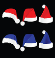 Christmas hat red and blue on black background vector