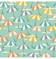 Seamless pattern in retro style with umbrellas vector