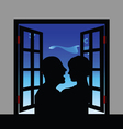 Couple silhouette front of window vector