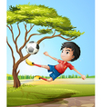 A boy playing soccer at the road vector