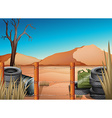 A desert with tires and a barbwire fence vector