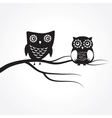 Two cute owls on the tree branch vector