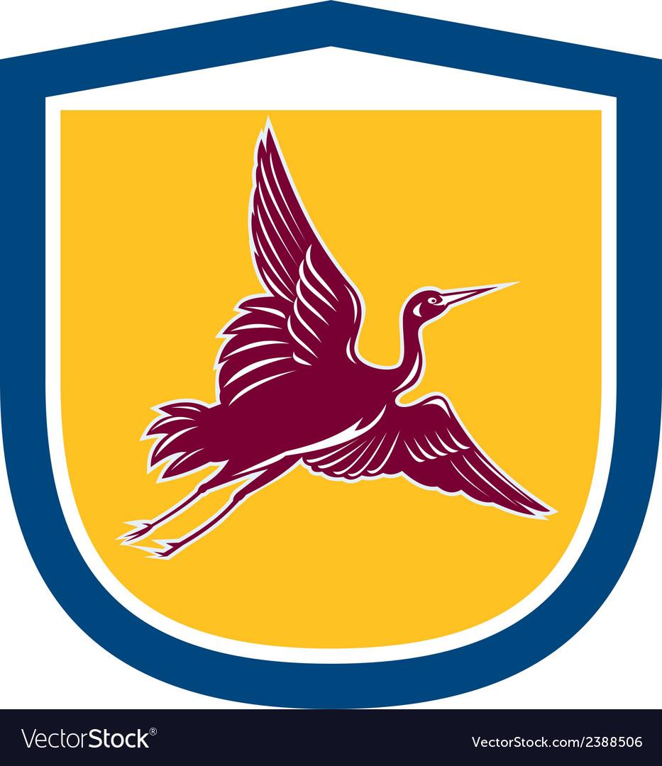 Heron crane flying side view shield retro vector | Price: 1 Credit (USD $1)