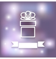 Gift on blurred background vector