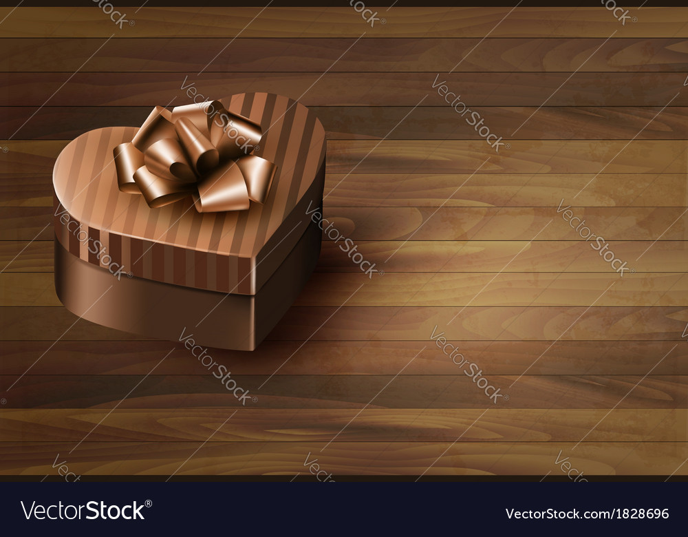 Heart-shaped gift box on wooden background vector | Price: 1 Credit (USD $1)