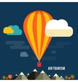 Hot air balloon flying over the mountain vector