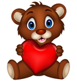 Cute baby brown bear cartoon posing with heart lov vector
