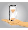 Hand holding a sandglass vector
