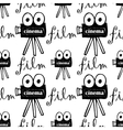 Seamless pattern with cameras vector