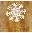White paper christmas snowflake on a wood  eps8 vector