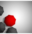 Red umbrella on a background of black umbrellas vector