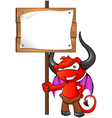 Devil mascot holding sign vector