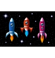 Three brightly colored rockets in outer space vector