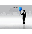 Businessman with light bulb on his hand concept vector