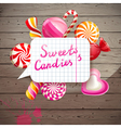 Wooden background with candies vector