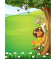A tree at the top of the hills with animals hiding vector