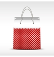 Vintage shopping bag in retro polka dots vector