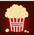 Red and white striped bag of popcorn vector
