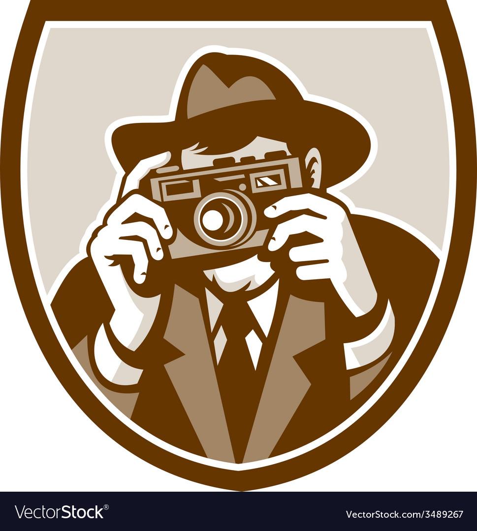 Photographer shooting camera shield retro vector | Price: 3 Credit (USD $3)