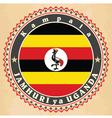 Vintage label cards of uganda flag vector
