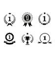 Set of black and white circular winner emblems vector