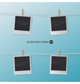 Retro photo frames on a rope with clothespins for vector