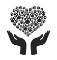 Hands hold heart paw symbol vector