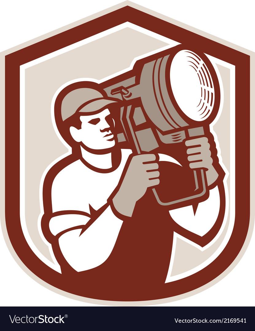 Electrical lighting technician carry spotlight vector | Price: 1 Credit (USD $1)