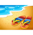 A pair of sandals at the beach vector