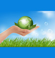 Human hand holding green globe vector
