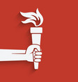 Hand with torch symbol vector