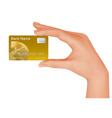 Hand with gold credit card vector