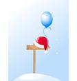 Santa's hat and blue balloon vector