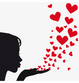Silhouette woman blowing heart vector