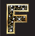 F gold letter with swirly ornaments vector
