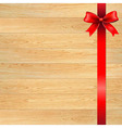 Red bow and blank gift tag with wooden wall vector
