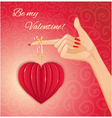 Woman hand with decorative paper red heart vector