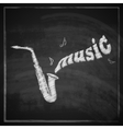 Vintage with the saxophone on blackboard vector
