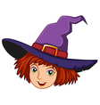 A smiling witch with a purple hat vector