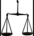 Black silhouette of scales of justice vector